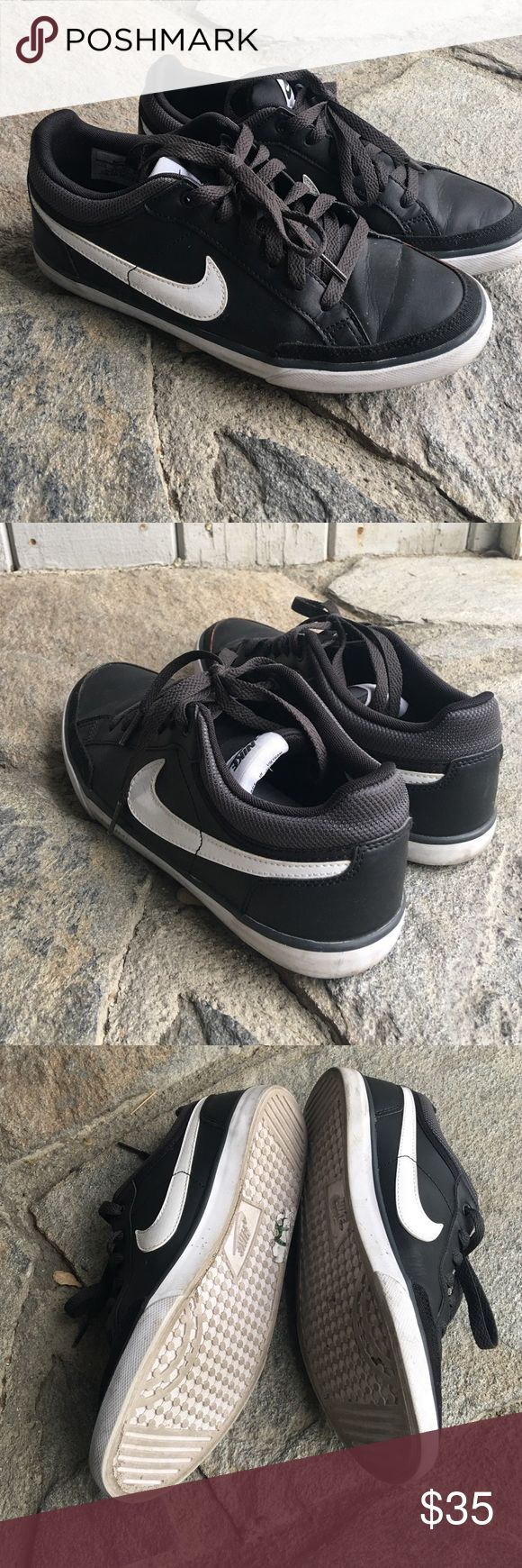 Nike black leather sneakers Black leather sneaker with white sole, lots of life left! Used the wrong shoe cleaner and accidentally bleached the front toe... price reflects condition. Might be fixed with dye? Nike Shoes Sneakers