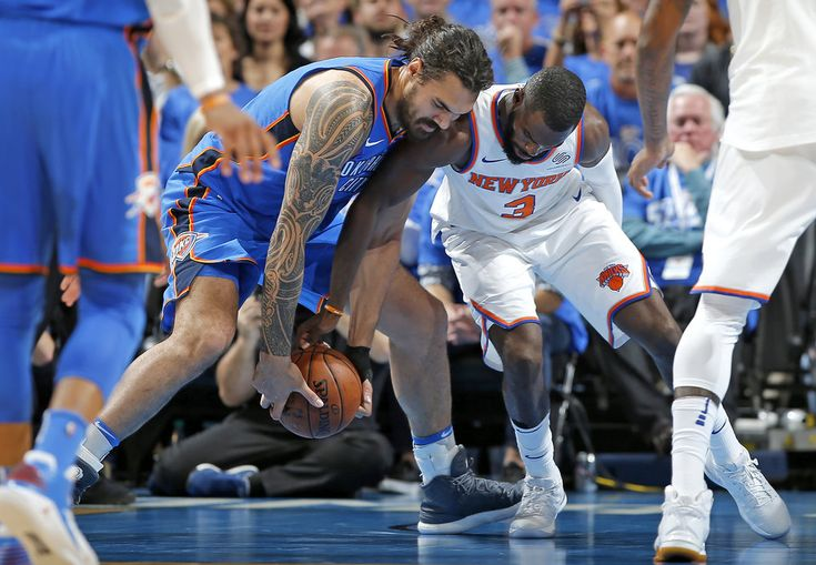 Oklahoma City\'s Steven Adams (12) goes for the ball beside New York\'s Tim Hardaway Jr. (3) during an NBA basketball game between the Oklahoma City Thunder and the New York Knicks at Chesapeake Energy Arena in Oklahoma City, Thursday, Oct. 19, 2017. Oklahoma City won 105-84. Photo by Bryan Terry, The Oklahoman