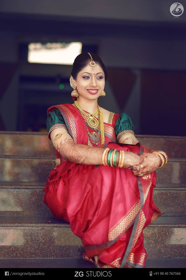South Indian bride. Gold Indian bridal jewelry.Temple jewelry. Jhumkis. Red silk kanchipuram madisar sari.Braid with fresh flowers. Tamil bride. Telugu bride. Kannada bride. Hindu bride. Malayalee bride.Kerala bride.South Indian wedding.