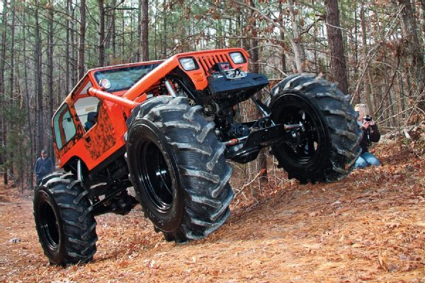 Farm tires offer awesome traction on this Jacked #Jeep YJ - Four Wheeler Magazine