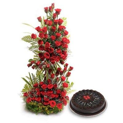 Love Never End Life size arrangement of 100 Red roses with mix seasonal fillers with 1kg Chocolate truffle Cake. Saugaat.in