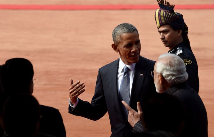 US President Barack Obama (C) speaks to Indian Prime Minister Narendra Modi as they walk through the... - Provided by AFP