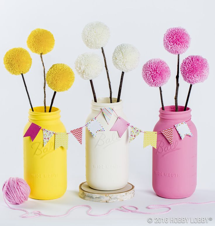 Tired of ordinary décor? Build your own spring spread with these adorable pom-pom bouquets! Simply adhere pom-poms to twigs with craft glue, and pop them in painted mason jars for a quick and quirky centerpiece.