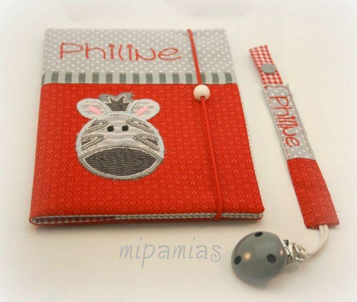 mipamias: U-Heft-Hülle mit Zebra und Schnullerband für Philine