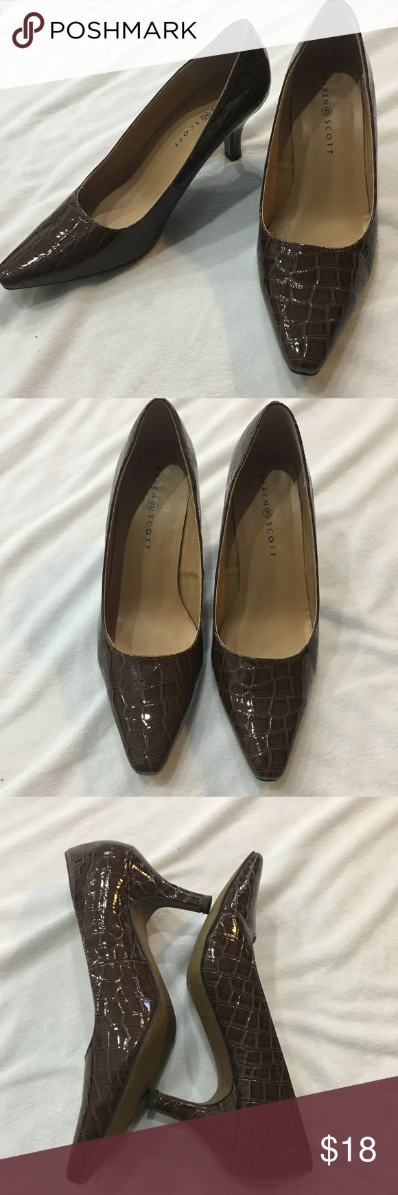"Karen Scott Rich Brown Faux Crocodile Skin Heels Karen Scott Rich Brown Faux Crocodile Skin Heels  Rich Chocolate Brown faux crocodile skin texture. Heel measures approximately 3"". Practically new - excellent condition! Toe of shoe is slightly squared off - not completely pointed (see picture). Excellent for work!  Would look great with brown pants or skirt. Karen Scott Shoes Heels"