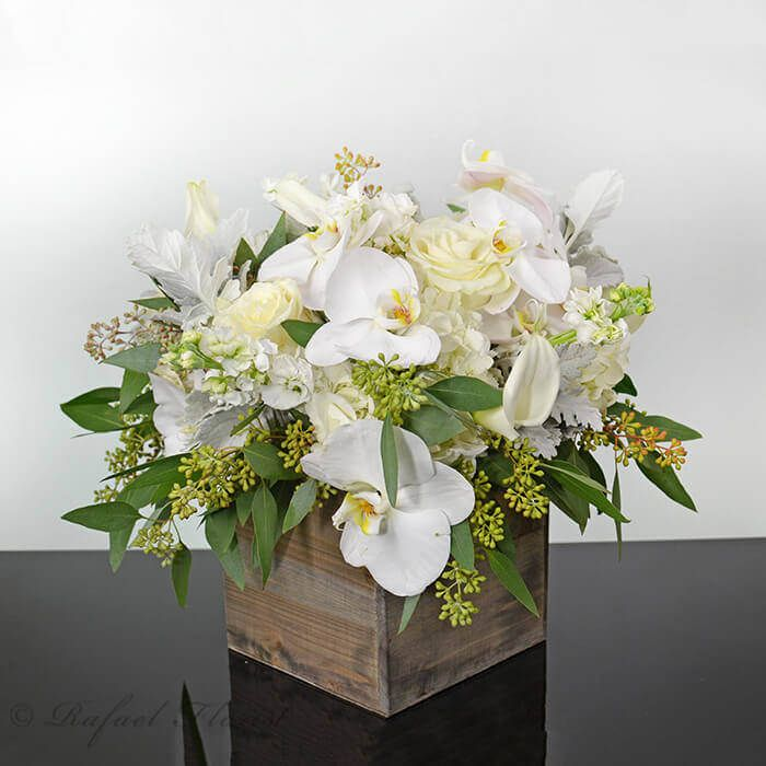 Rustic Floral Design Of White Phalaenopsis Orchids Roses Calla Lilies Rustic Flower Arrangements Floral Arrangements Orchid Arrangements