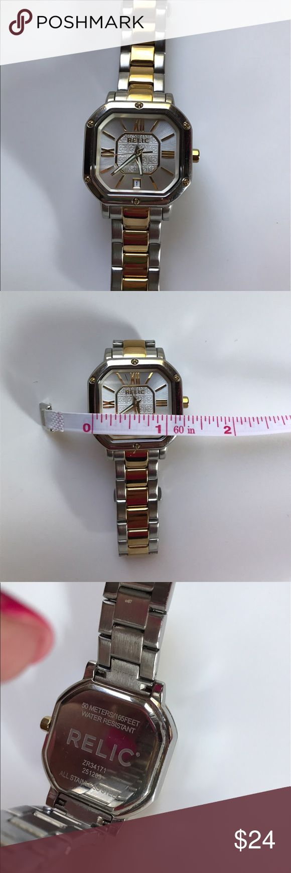 Relic watch Ladies large face Relic watch in gold and silver tones with date feature. Water resistant to 50m. Stainless steel back and clasp. Worn many times. No scratches or signs of wear. Brand new battery! Relic Jewelry
