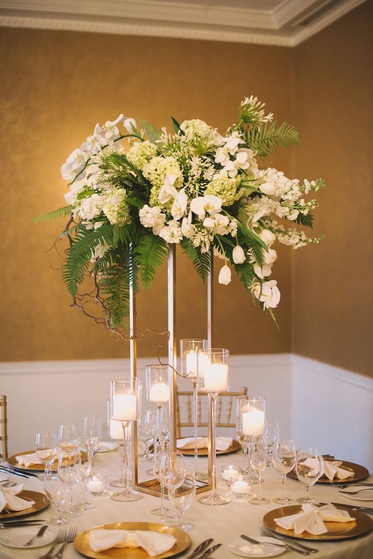 21 Of The Awesomely Affordable Wedding Centerpiece Inspirations For The Reception Ta Wedding Table Centerpieces Tall Wedding Centerpieces White Wedding Flowers