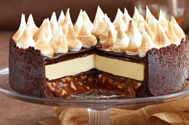 We're nuts about this star cheesecake! With its rich ganache, salted peanut caramel and white chocolate filling, all on a chocolate biscuit crust, every slice is a triple-choc treat. Start this recipe at least one day ahead of serving.
