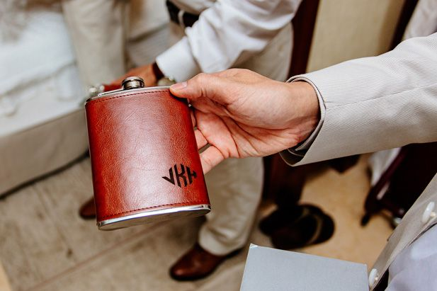 Groomsmen gift idea: personalized flasks (Photo by Melissa Mercado Photography)