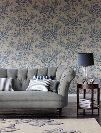 Keep florals gender neutral by choosing shades of beige, grey and blue. Keep furniture chunky and choose dark wood for a more masculine feel that will keep the whole family happy! Botanical rose wallpaper, John Lewis.