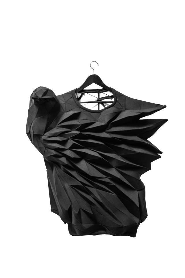 a 3d tshirt fashion graduate piece artwork , looks like the sculpture of a raven or crow amazing fabric manipulation #NaaiAntwerp