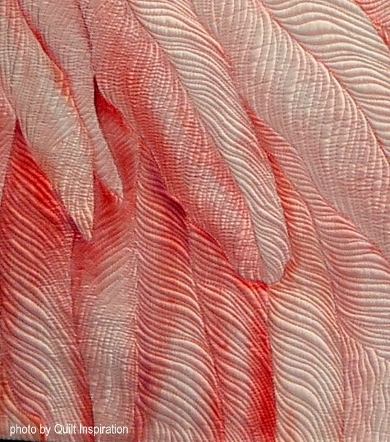 "Close-up 'Tickled Pink' Second-place winner in the Art-Painted Surface category Houston Quilt Festival. The quilt was painted with steam-set dyes on silk habotai."" ( a fabric with a soft and supple hand and a lustrous sheen)"