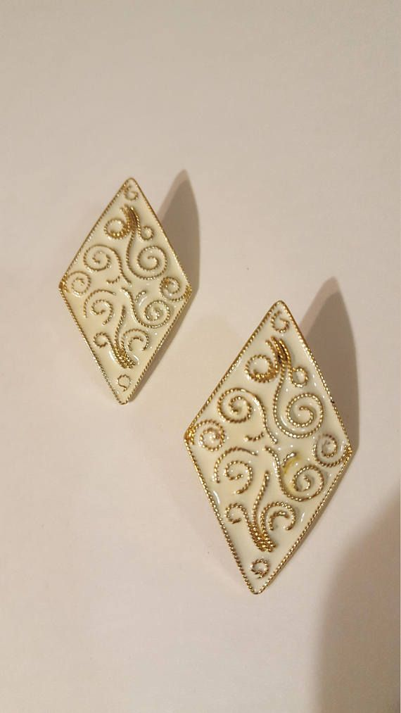 Check out this item in my Etsy shop https://www.etsy.com/ca/listing/578964975/vintage-gold-swirl-earrings-faux-gold