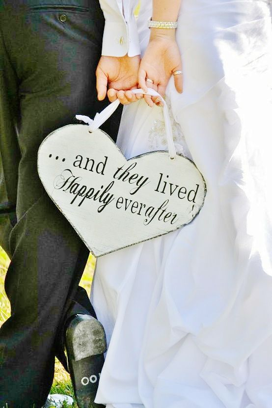 """""""...and they lived happily everafter"""" sign. Cute for the ring bearer and flower girl to carry down the aisle after the ceremony"""