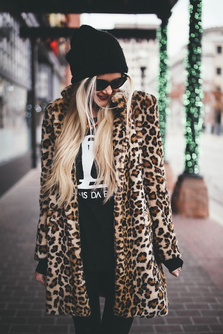 Oversized leopard jacket and black beanie. Winter wardrobe street style.