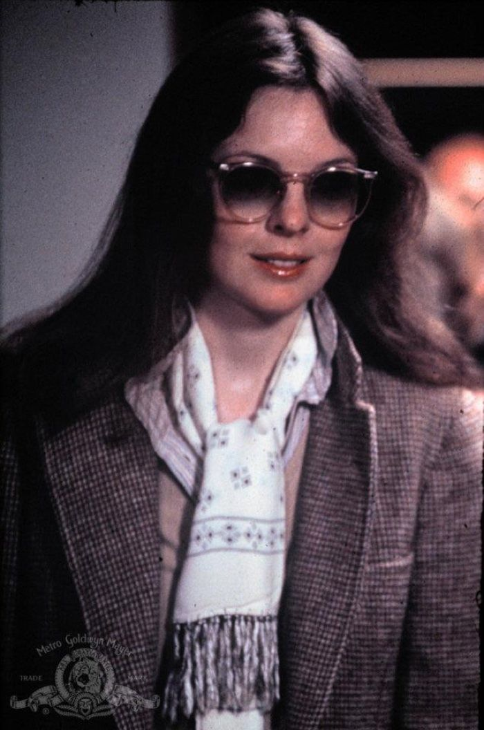 Diane Keaton accessorizes in style as Annie Hall wearing oversized sunglasses, a printed scarf and tailored coat.