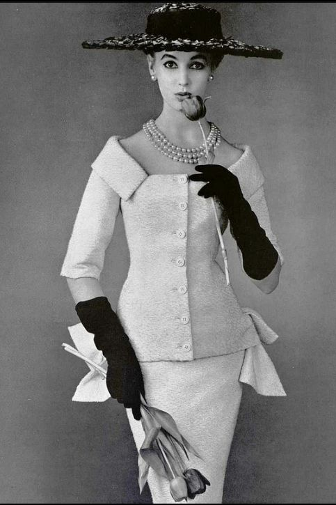 1955 Model in two-piece dinner/cocktail suit of white embossed rayon/cotton by Jacques Fath, photo by Seeberger