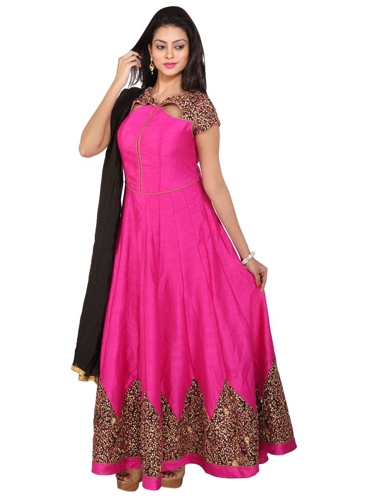 Dazzle everyone around with this captivating Magenta and Black Raw Silk Anarkali Gown with fancy leaf shaped cutouts near neckline and contrasting heavy thread and sequins embroidery on neckline, sleeves and border of the dress. It has a fancy cutout on the back.