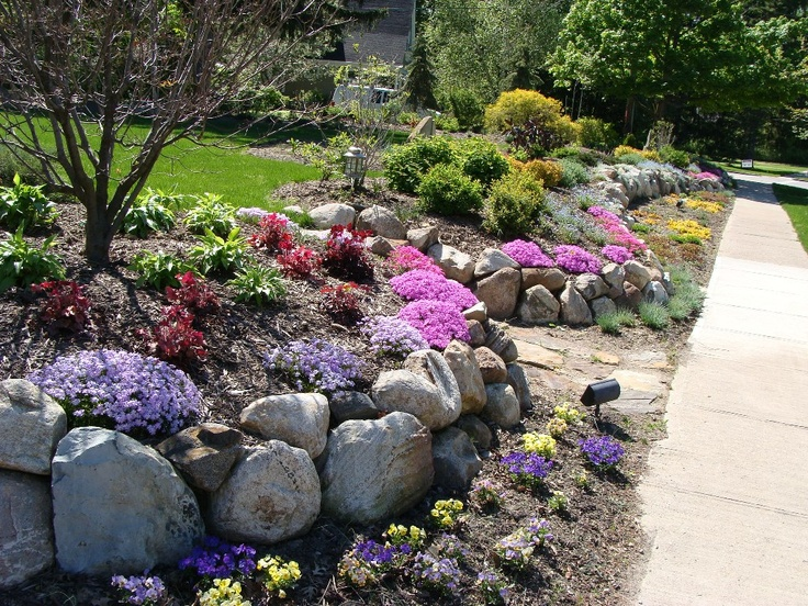 Maple leaf landscaping rock wall garden garden design for Rock wall garden designs