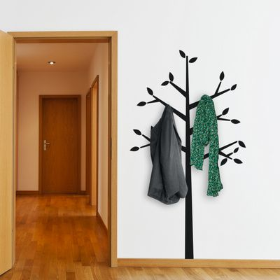 I totally love this idea for a wall decal/coat/hat/scarves rack :)