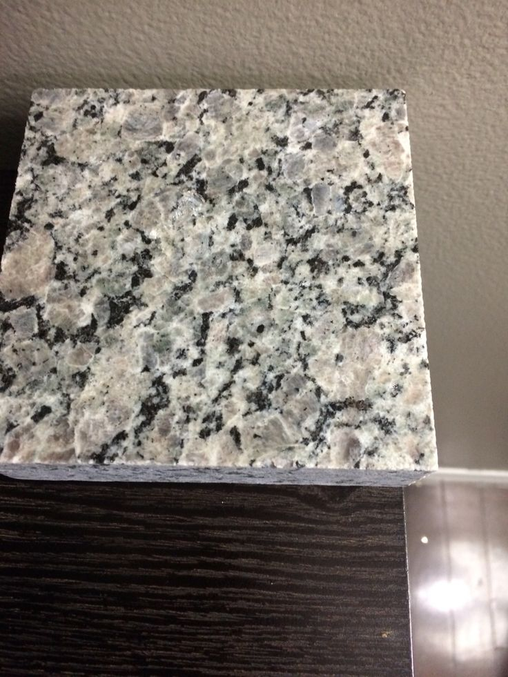 New Caledonia granite, espresso cabinets, greige paint color  think I