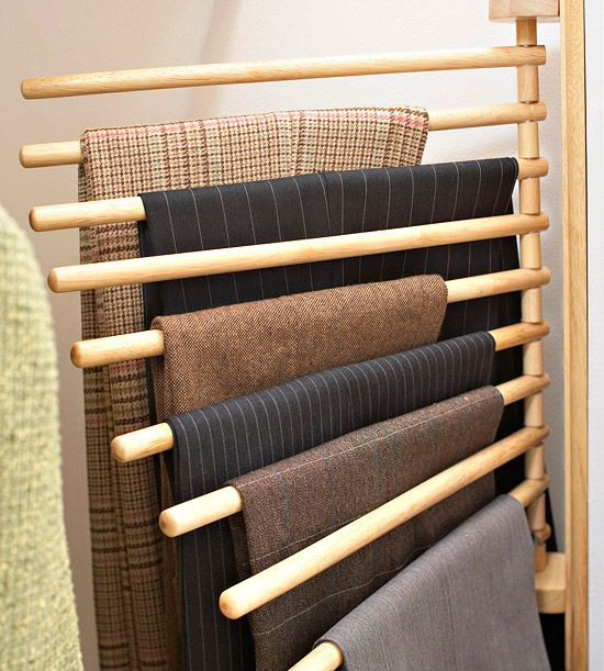 Trouser organization in a closet With pressed shirts, jackets, and dresses taking up most of the hanging space, this clever wall-mounted trouser rack fits snugly on the depth of the side wall  and provides 10 spots to hang dress pants. Plus, the rods swivel, making it easy to grab just one pair of pants at a time.