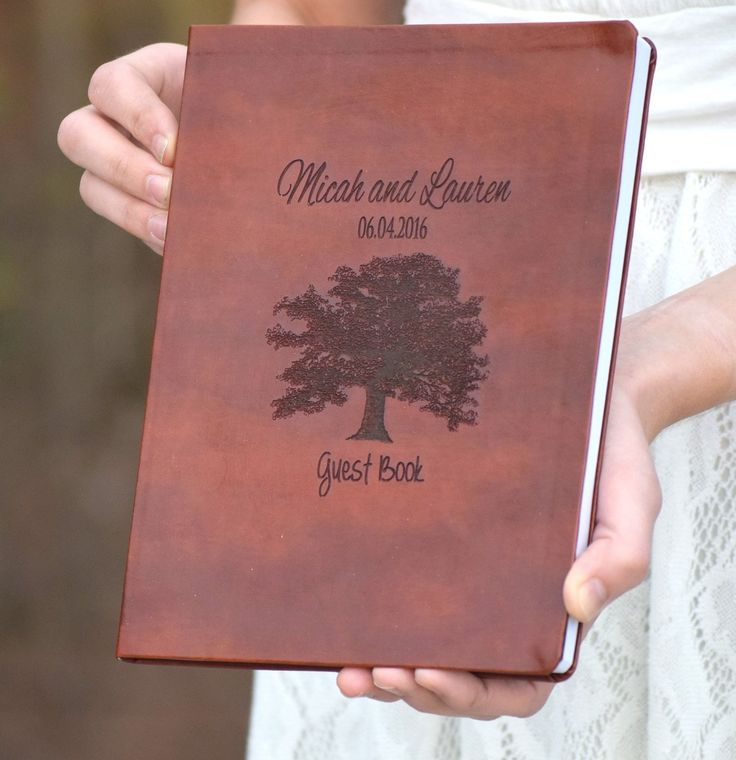 "Leather Engraved Oak Tree Book - Wedding Guest Book - Leather Journal - Personalized Journal - Personalized Gift - Guest Book Alternative - Personalized Leather Journal. This beautiful leather custom wedding guest book can be customized with your names and wedding date. There are additional font options available. This leather book is approx. 8"" wide x 1"" thick x 10"" tall (vertical position). It includes 256 lines 2 sided pages for journal entries and/or notes from your wedding guests…"