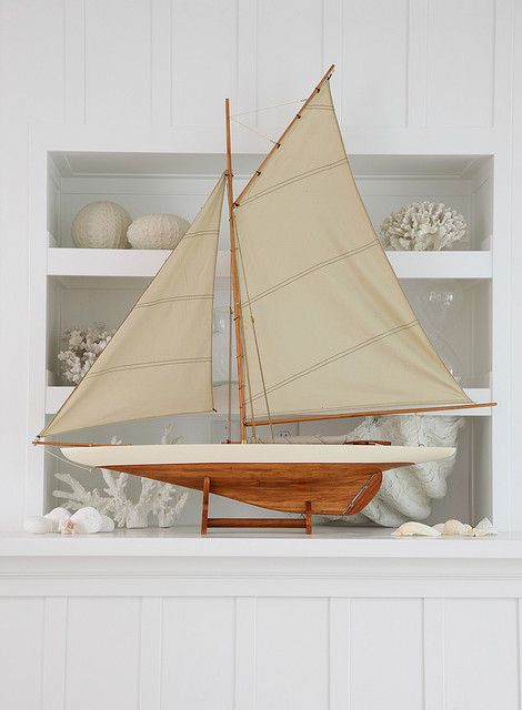 Just beautifully simply, and classic nautical. Something about adding a model sailing ship instantly classic decor