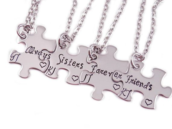 This listing includes a set of FOUR 5/8 x 1 hand stamped stainless steel puzzle piece necklaces, each on a stainless steel chain of your choosing.