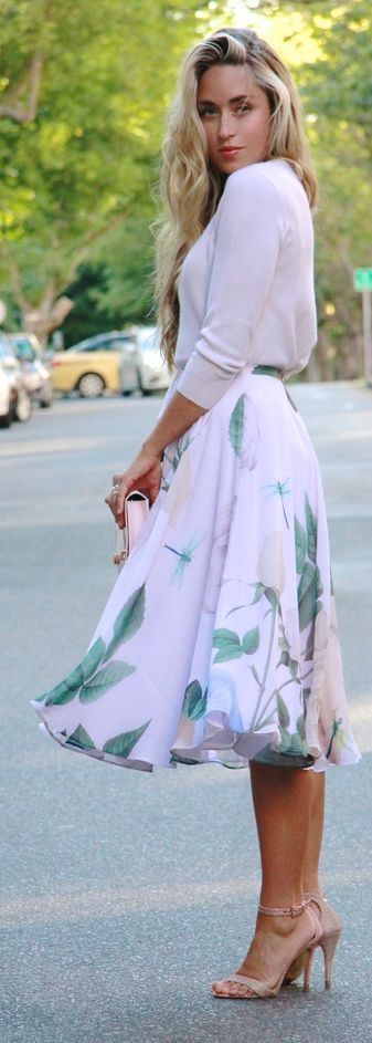 Floral Midi Skirt by A Fashion Love Affair. Paired with a pink clutch!