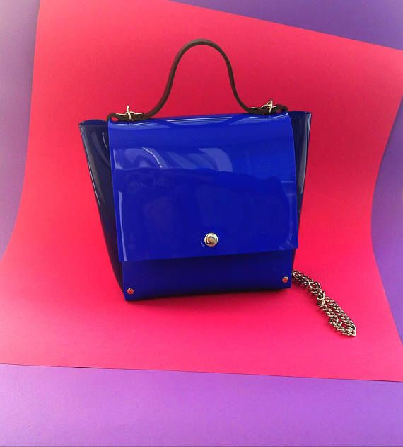 Blue pvc bag, glossy PVC crossbody, standout design messenger, blue vinyl shoulder purse, minimal blue medium satchel, unique woman handbag  Dimensions: 20 x 20 x 7 cm // 7,87 x 7,87 x 2,76  chain 110 cm/ 43 inches  Made of thick, flexible PVC. A medium handbag city, type of messenger