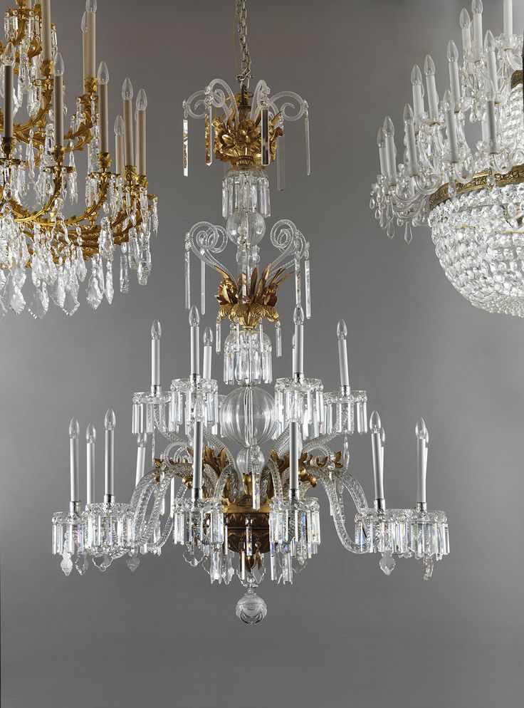 An exceptional giltwood and Crystal antique chandelier, flanked by his brothers: a gilt bronze and crystal Louis XV style chandelier and an empire style bohemian Crystal 100 lights chandelier