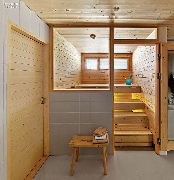 A House For All Seasons: A Retreat For Finnish Architect Anssi Lassila | Entered through the bathroom, a sauna features spruce seating up-lit by LED strips. #design #interiordesign #interiordesignmagazine #architecture #wood #sauna