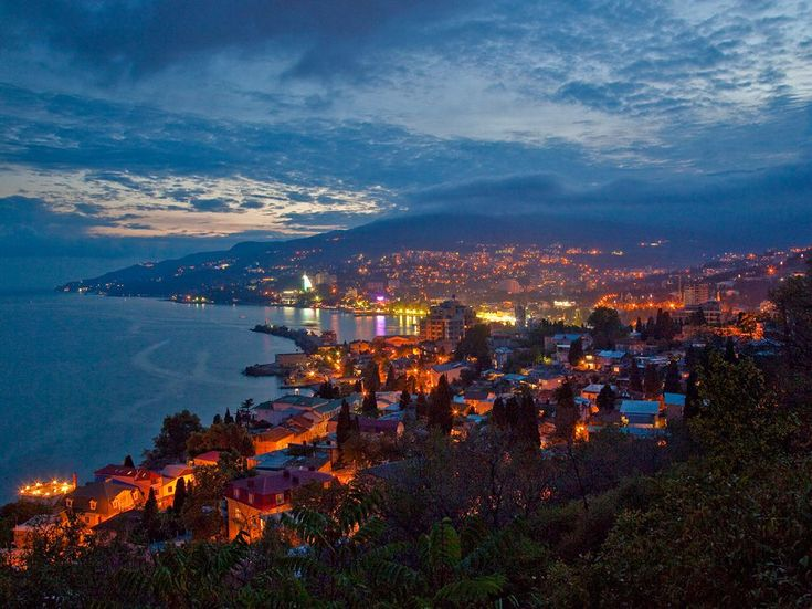 "Yalta-Phosphorescent dusk settles over Yalta, a fashionable resort for Russian nobility in the 19th century, war scorched in the 20th. Winston Churchill, participating in the 1945 conference that reconfigured postwar Europe, called the area the ""Riviera of Hades."" - Photograph by Gerd Ludwig, National Geographic"
