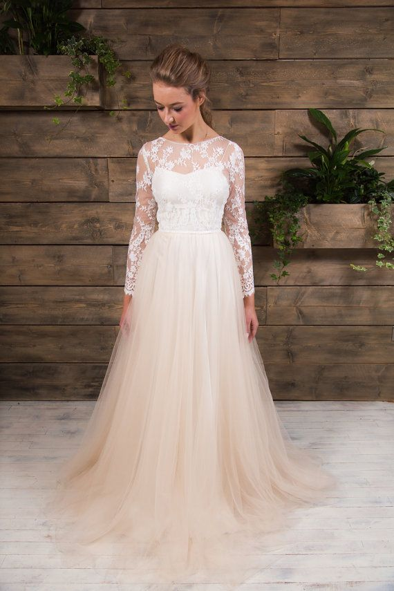 "AMAZING Lace and Tulle Wedding Bridal Dress from eandw- UK seller on Etsy. ""Billie is a laser lace bodice with elaborate edging to the long sleeves. She has a layered full circle tulle skirt in a peach tone and a low back with button detailing.  It comes with a slip under dress in Ivory or Champagne.  Bespoke option available."""
