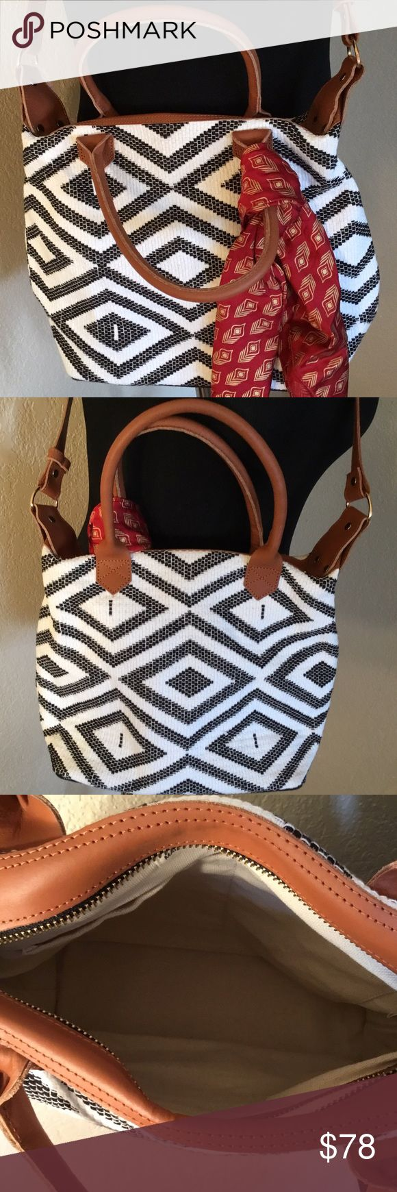 Aztec Shoulder Bag Black/White Aztec bag with brown leather. Straps, heavy duty bag, only carried for less than a week...comes with scarf... measures 14x10x5.5 handle drop 5.5 , cross body strap 17 , zip top closure, 2 slip pockets, an 1 zipper pocket...beautiful bag .. Tribe Alive Bags Shoulder Bags