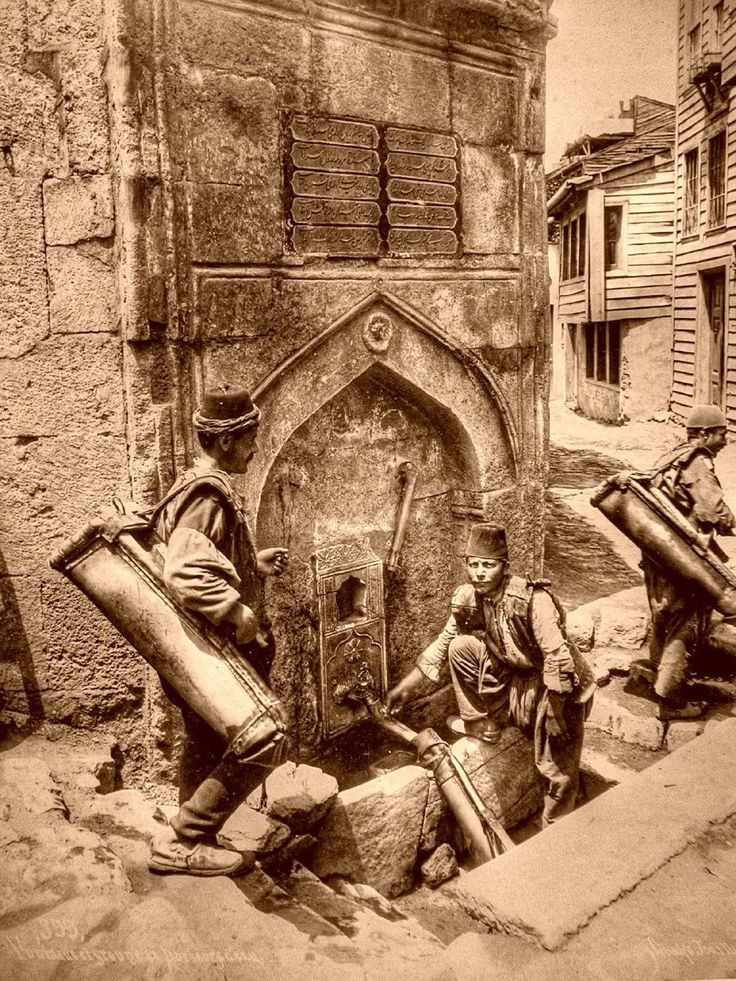 Water bearers. Saliha Sultan Fountain in Azapkapi, İstanbul, c. 1890-1900.