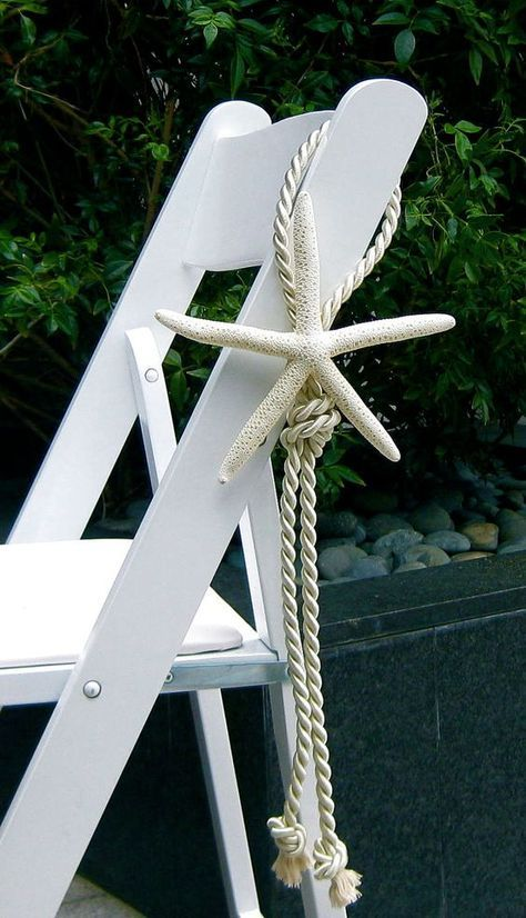 Beach wedding idea! Love the rope and nautical knot
