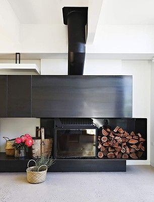 A massive Cheminees Philippe wood heater from France is a feature of the open-plan living space. www.chemphilaust.com.au