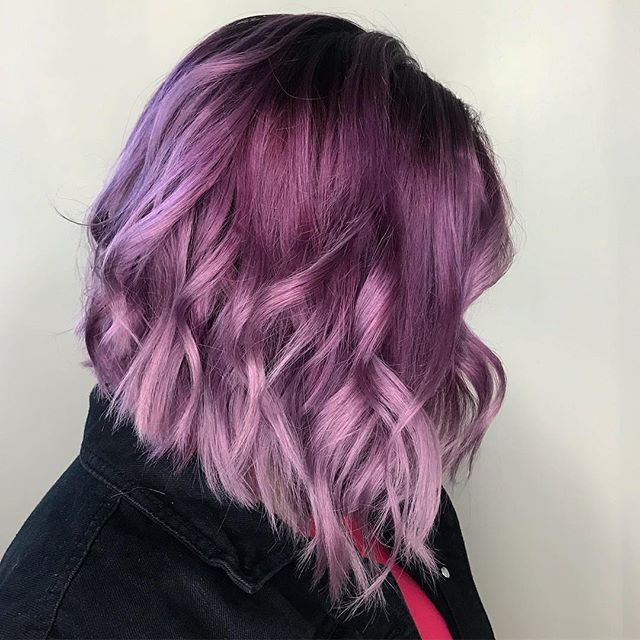 """Pantone's Color of the Year is """"Ultra Violet,"""" and we're obsessed with its bright, happy vibes. This vibrant violet hair color by Aveda Institute student @a_touch_of_chey is the perfect purple."""