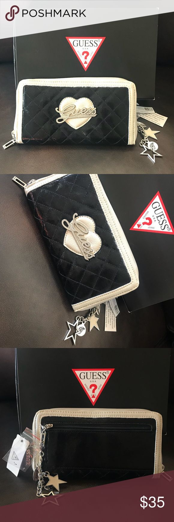 Brand New GUESS Black Patent Leather Zip Wallet Brand New GUESS Black Patent Leather Zip Wallet, made up with Beige Leather trim. Guess Logo piece attached on front with gems on beige leather heart. Back has length size zipper with Guess Stars, & oval Charms hanging. Inside made up of Tan Leather, 8 credit card pockets, middle zip pocket, & 6 full length size slots. Box, original ticketing, stuffing & 6 replaceable gems are INCLUDED with purchase. Guess Bags Wallets