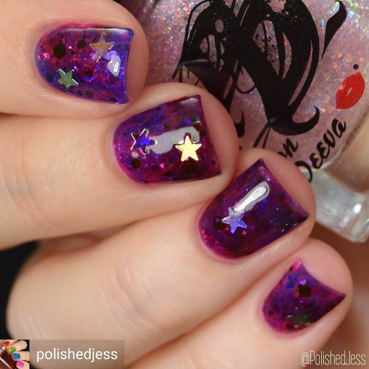 Honestly these nails 😍☄☄ @Regrann from @polishedjess - May's @naildramabox is galaxy themed, which I absolutely love! I created this @madamluck-inspired galaxy mani using iridescent star glitter from the May @naildramabox, Blueberry, Strawberry, and Cherry from @thedondeeva's Rock Candy Jints over a base of @thedondeeva's, March @hellaholocustoms exclusive, Stripper Glitter with @kraftygurldesigns's Mindnight Masquerade. I topped this off with @justricarda's Glossy Glam.  #thedondeeva