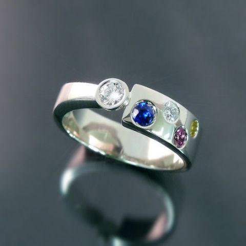 custom made modern family ring with diamond and birthstones - Like this!! big one for mama and little ones for the kids...