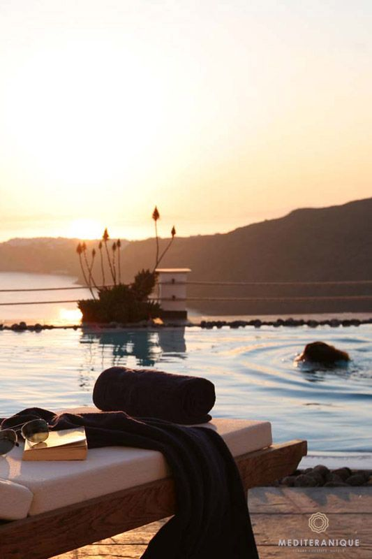 Sunlounger by the swimming pool at the Rocabella Santorini