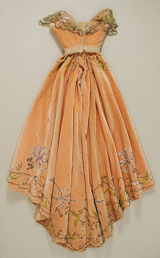 Beaded and embroidered apricot silk velvet ball gown with rhinestone and sequin embellishment and silk floral corsage (back), by Jacques Doucet, French, 1898-1900.