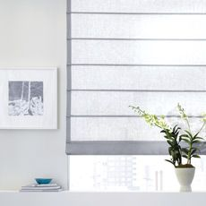 Add a touch of Zen to your room today. Our modern Asian-inspired Aventura Roman Shades feature decorative rod pockets sewn to the front of the shade.