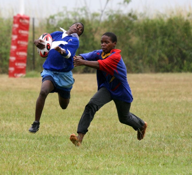 Watching children pick up a rugby ball for the first time inspired me to write My Rugby ABC Book. Two children from Swaziland enjoying the game.