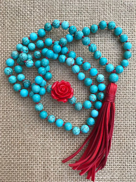 Necklace is made of: 8mm Turquoise dyed howlite stone beads 1 Red Rose decorative bead Handmade deerskin Red leather Tassel Red Nylon Knotting Thread Length: Approximately 36 ins plus 4 in tassel (can be trimmed to desired length) I want you to be 100% satisfied. If for any