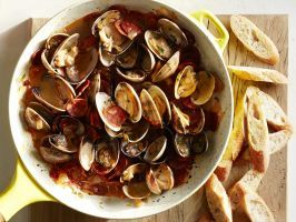 Clams with Chorizo : Alongside crusty bread, this buttery seafood dish served right from the saute pan makes a beautifully simple and rustic appetizer.